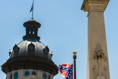 A Confederate flag flies on the Statehouse grounds in Columbia, South Carolina, in this photo taken in June. Gov. Nikki Haley signed a bill removing the flag from the grounds July 9. The flag was to be removed within 24 hours of the governor's signature. (CNS photo/Mic Smith, The Catholic Miscellany)