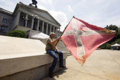 A man holds a Confederate flag outside the Statehouse in Columbia, South Carolina,  July 9, hours before Gov. Nikki Haley signed a bill to remove the flag from Statehouse grounds. (CNS photo/Jason Miczek, Reuters)