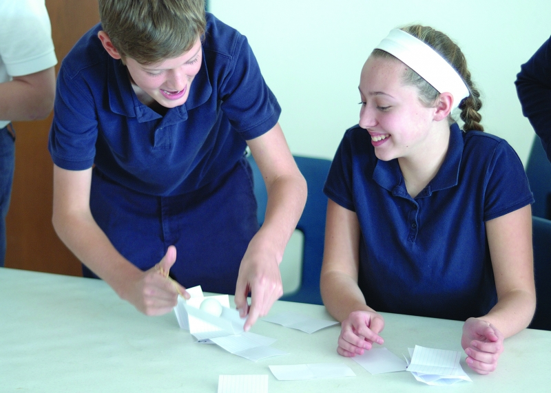 Good Shepherd eighth graders Ryan Kelley and Grace Green participate in an engineering activity to build a tower out of index cards.