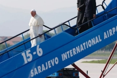 Pope Francis arrives at the international airport in Sarajevo, Bosnia-Herzegovina, June 6. The pope was making a one-day visit to Bosnia-Herzegovina to encourage a minority Catholic community in the faith, and to foster dialogue and peace in a nation still largely divided along ethnic lines. (CNS photo/Paul Haring)