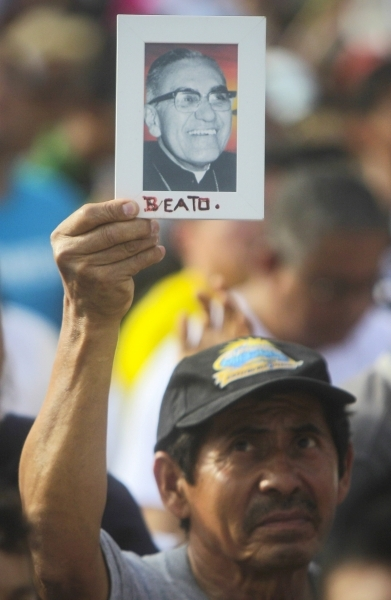 Pilgrim holds portrait of Archbishop Oscar Romero during beatification Mass in the Divine Savior of the World square in San Salvador May 23. CNS photo by Oscar Rivera, EPA.