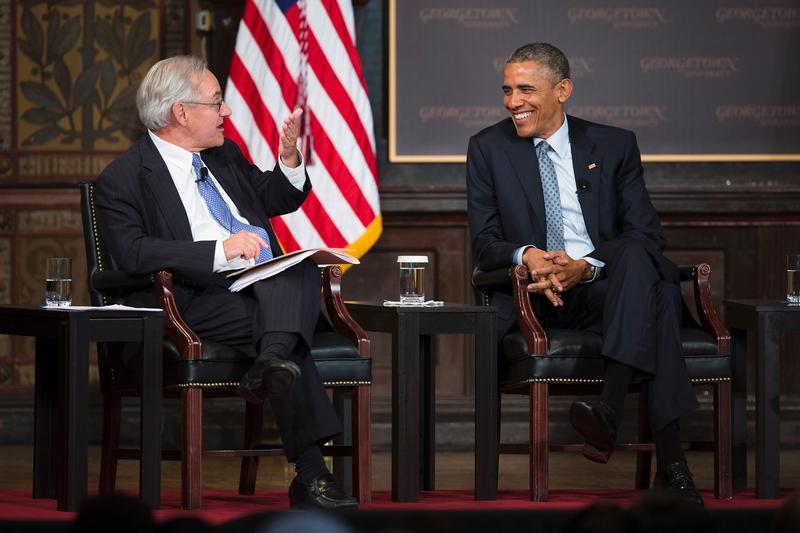 U.S. President Barack Obama shares a light moment with E.J. Dionne Jr. of the Brookings Institution May 12 during the Catholic-Evangelical Leadership Summit on Overcoming Poverty at Georgetown University in Washington. CNS photo by Tyler Orsburn.