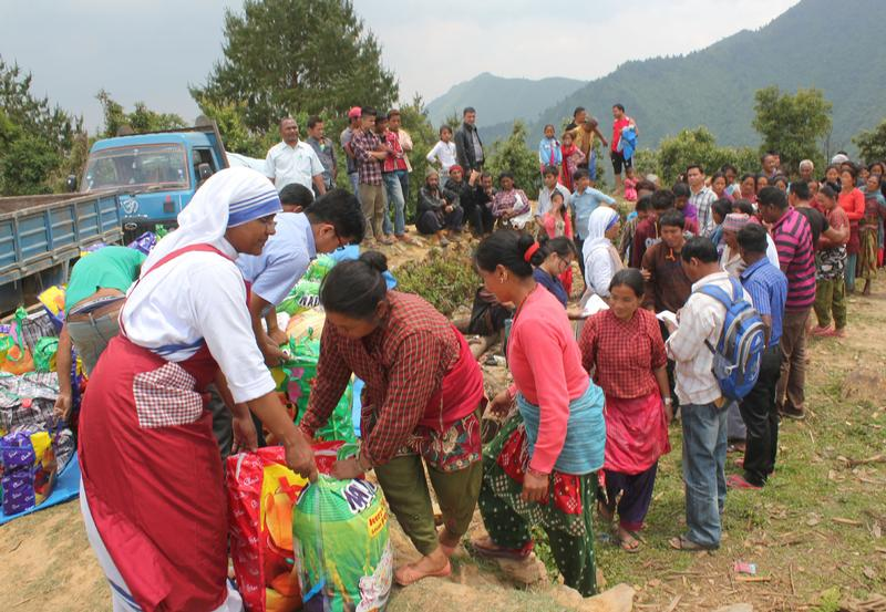 A member of the Missionaries of Charity helps distribute relief items to earthquake victims May 16  in the mountains overlooking Kathmandu Valley in Nepal. CNS photo by Anto Akkara.