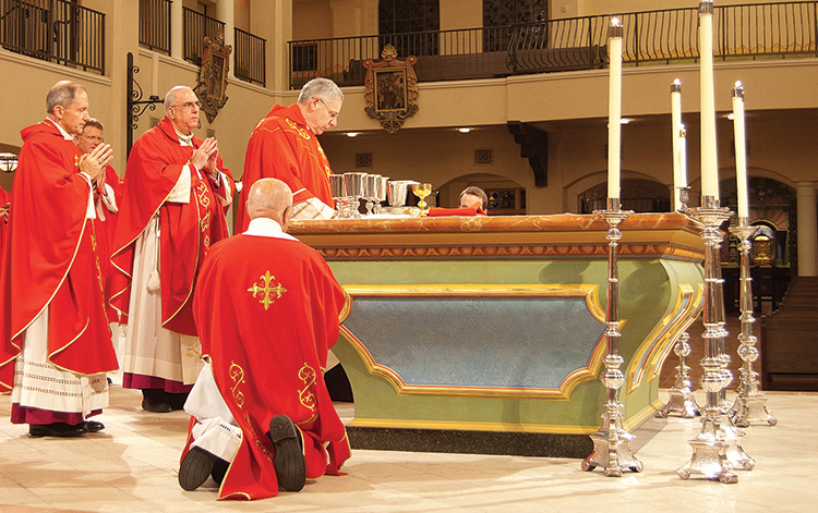 Bishop Robert W. Finn celebrates the annual Red Mass Oct. 23 at Visitation Church in Kansas City, Mo. Concelebrating with Bishop Finn are Bishop Thomas J. Paprocki of the Diocese of Springfield, Ill., left, and Archbishop Joseph F. Naumann.