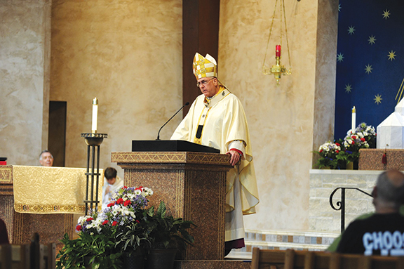 Archbishop Joseph F. Naumann drives home the importance of religious liberty and conscience rights during a Mass July 4 at Church of the Nativity in Leawood during this year's Fortnight for Freedom.