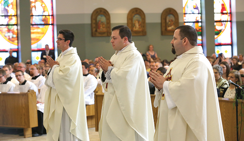 Deacons Jaime Zarse (left), Anthony Saiki and Adam Wilczak were all ordained priests for the Archdiocese of Kansas City in Kansas on May 25 at Prince of Peace Parish in Olathe.