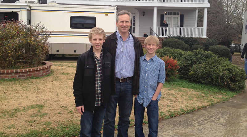 "Dan Stalp and his sons Jackson (left) and Dominic (right) stand in front of the house used in filming ""A Long Way Off,"" a recently released Christian-themed movie based on the parable of the prodigal son. The Stalps were extras in the prodigal son reunion party scene."