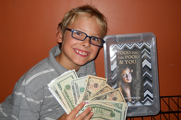 Isaac Dessert, 8, a member of Sacred Heart-St. Casimir Parish in Leavenworth, has raised about $400 toward his goal of $3,200 to provide a home for a family in Haiti through Food for the Poor.