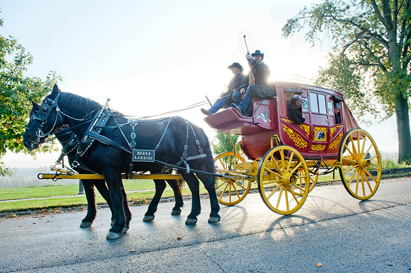 Robin and Rick Dunn of Dunn's Landing in Wellsville lead the stagecoach full of Carmelite dignitaries from Riverfront Park to Immaculate Conception Church in Leavenworth. Photo by Todd Habiger.