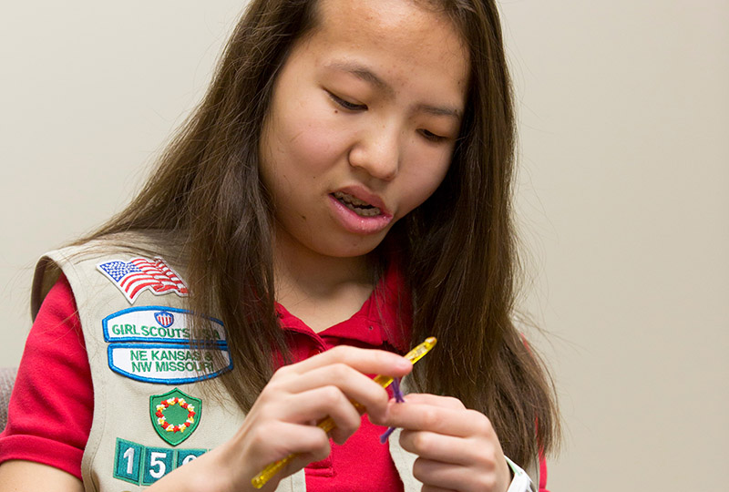 Meah Copeland, an eighth-grader at St. Joseph School in Shawnee, crochets a chemotherapy hat for cancer patients.