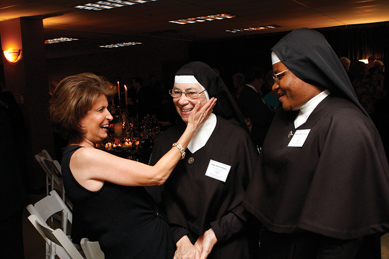 Mary Sullivan, left, organizer of the Sisters, Servants of Mary fundraising gala, jokes with Sister Leticia Rodriguez, center, and Sister Sylvena Tetuh at a past event at Church of the Ascension in Overland Park.
