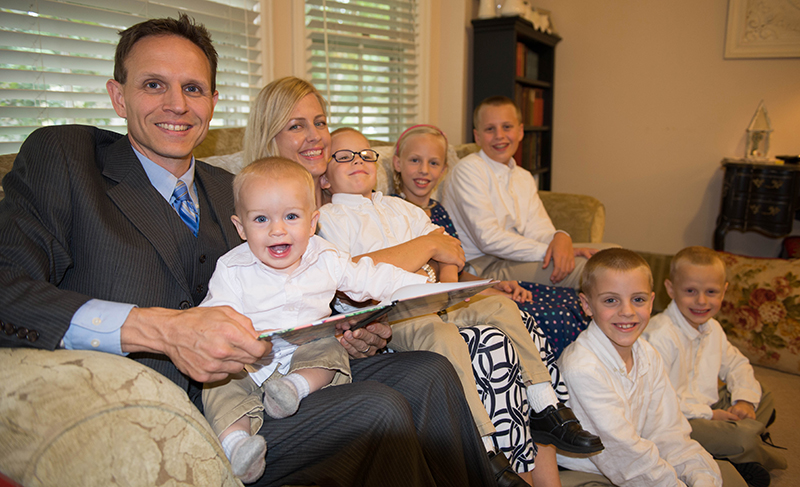 Patrick and Shannon Watkins relax with their children (from left) Talbot, 1; Becket, 3; Dymphna, 11; Malachi, 12; Declan, 8 and Eamonn, 6. When they learned before Talbot was born that he might be very sick, they prayed for his health and the safety of Shannon through the intercession of Matt Talbot, a poor laborer in Dublin who died in 1925. Talbot, an inspiration for alcoholics and those suffering other addictions, could be beatified if the circumstances surrounding the child's birth are deemed a miracle. Photo by Joe Bollig