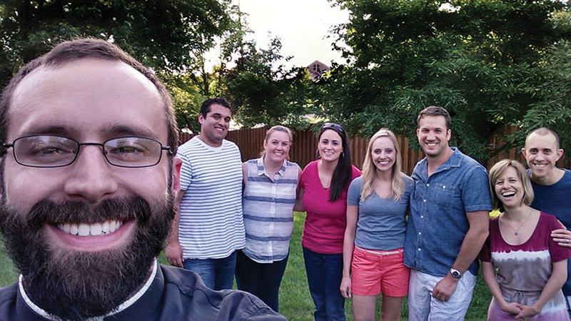 Father Nathan Haverland takes a selfie with some members of the young married group at Church of the Ascension in Overland Park. The group hopes to expand their membership by offering an array of faith-sharing opportunities. Above, from left, are Father Haverland, Ignacio Contreras, Kate Contreras, Laura Jennison, Angela Moburg, James Moburg, Sasha Franzen, and Paul Franzen.