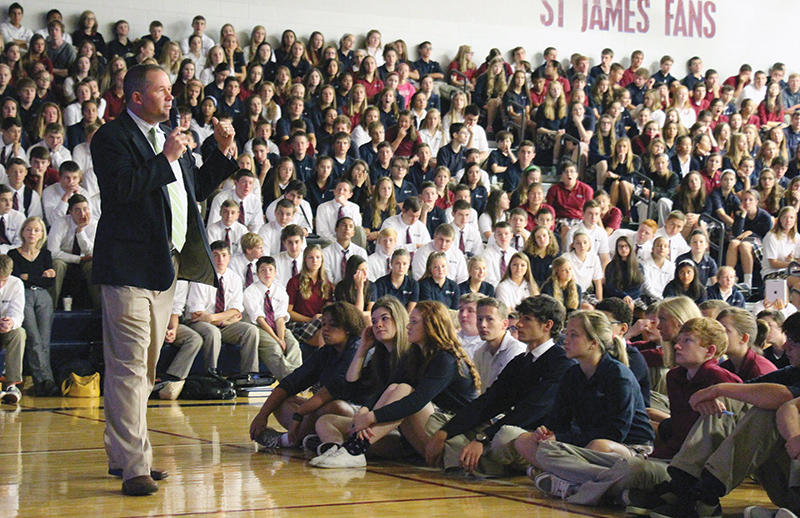 """Andy Tylicki, president of St. James Academy in Lenexa, announces to the student body that the school was named a 2014 """"School of Excellence"""" on the Catholic Education Honor Roll.  Photo courtesy of St. James Academy."""