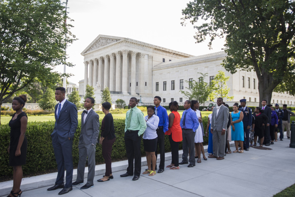 People line up outside the U.S. Supreme Court in Washington June 25, the day the justices upheld the nationwide tax subsidies under President Barack Obama's health care overhaul. The 6-3 ruling preserves health insurance for millions of Americans. Photo by Jim Lo Scalzo for CNS) See SCOTUS-ACA.
