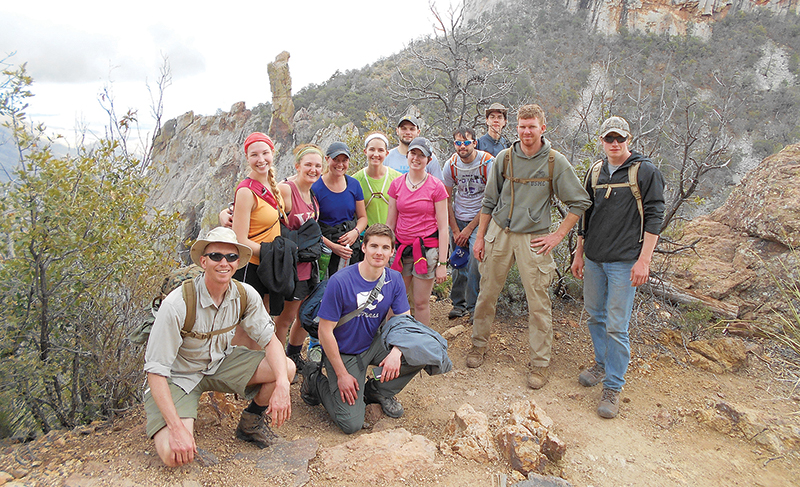 The group poses for a photo on the way down from Mass at Emory Peak. From left are, stand- ing: Hayley Normandin, Washburn; Felicia Sullivan, Emporia State; Shianne Cokely, Emporia State; Sophia Olsen, Pittsburg State; Matt Glazier, Emporia State; Chloe Mooradian, Washburn; Thomas McAnerny, Kansas State; Alex Hajek-Jones, Emporia State; Nicholas Downey, Kansas State; Derek Haug, Kansas State; and kneeling: Father Nick Blaha and Bob Schroeder, Kansas State.