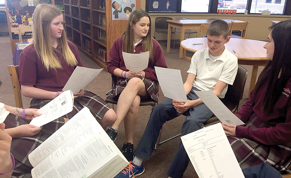 """From left, Brianna Streeter, Cole Sheridan and Katie Cosse, students at Sacred Heart of Jesus School in Shawnee, share insights they gained about themselves and their faith during the """"Honor Project"""" this winter. Photo courtesy of Kathy Clevinger."""