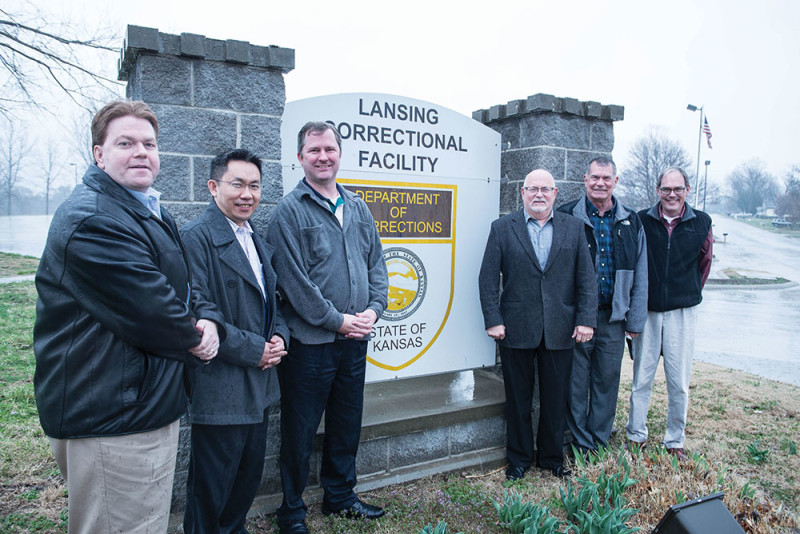 From left, deacon candidates Joe Allen, Phillip Nguyen, Chris Slater, Mike Moffitt, John Stanley, and Steve White stand outside the Lansing Correctional Facility before starting their weekly ministry to prisoners.