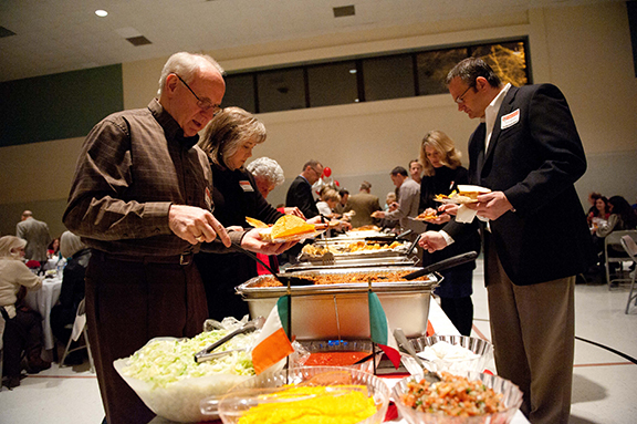 "LEAVEN PHOTO BY LORI WOOD HABIGER A crowd of 250 dined on a veritable feast of ethnic food at Resurrection School's inaugural ""A Taste of KCK"" benefit. The cuisine was a nod to the school's and neighborhood's ethnic diversity."