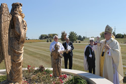 Archbishop Joseph F. Naumann blesses the new Guardian Angel Shrine in the infant burial section of Gate of Heaven Cemetery Oct. 3. By Therese Horvat.
