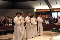 Alessandro Borraccia (left), Mirco Sosio, Scott Kallal, Vince Huber and Edward Ahn present themselves to Archbishop Naumann for ordination. Borraccia was ordained to the diaconate while the other four were ordained to the priesthood.