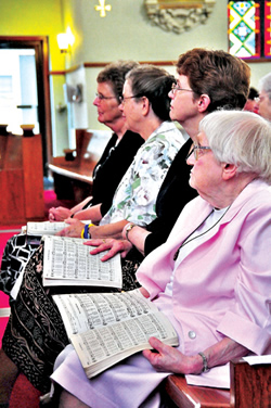 From left to right, Benedictine Sisters Anne Shepard, Delores Dolezal,  Rose Marie Stallbaumer and Mary Ethel Burley participate in the June 26 Mass honoring their order's 135-year service to Sts. Peter and Paul Parish in Seneca.