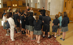 Father James Albers, OSB, prior of St. Benedict's Abbey, Atchison, leads the vocations club of Holy Cross School in Overland Park on a tour of the abbey. By JD Benning.