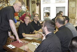 Archbishop Joseph F. Naumann spends some time with seminarians before a meal in Madrid. Pictured clockwise from left are: Justin Hamilton, Dan Morris, David Pratt, Father Bill Bruning, and Nathan Haverland.