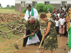 Paul and Nancy Berrigan break ground on a new science and learning center at John Paul School in Uganda. The couple was instrumental in building the school (below) and have recruited some Bishop Ward classmates to help support the school financially.