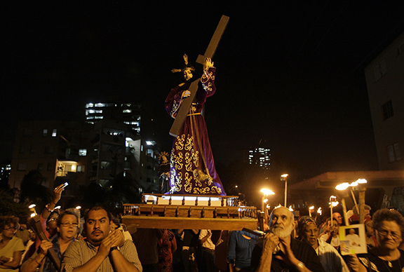 People take part in an outdoor Stations of the Cross procession in Havana March 7. Cuba's government, after a request from Pope Benedict XVI, declared Good Friday 2012 a national holiday.