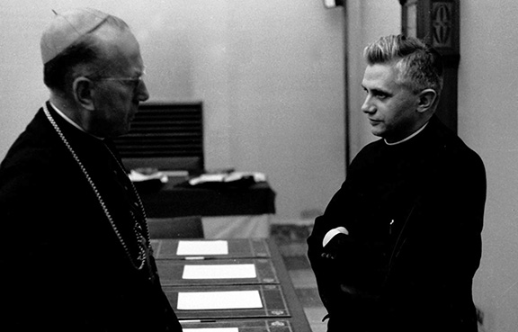 CNS PHOTO FROM KNA Father Joseph Ratzinger, right, talks with an unidentified prelate in this photo taken in 1962 during the Second Vatican Council. The future Pope Benedict XVI attended all four sessions of the council as a theological adviser to German Cardinal Joseph Frings of Cologne.