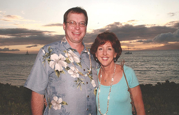 PHOTO COURTESY OF PAUL SMITH Michelle Stueve Smith and her husband Paul enjoy the Hawaiian sunset during a vacation in 2009 just months before she was diagnosed with melanoma. A scholarship has been set up in her name at John Paul II Grade School in Overland Park.