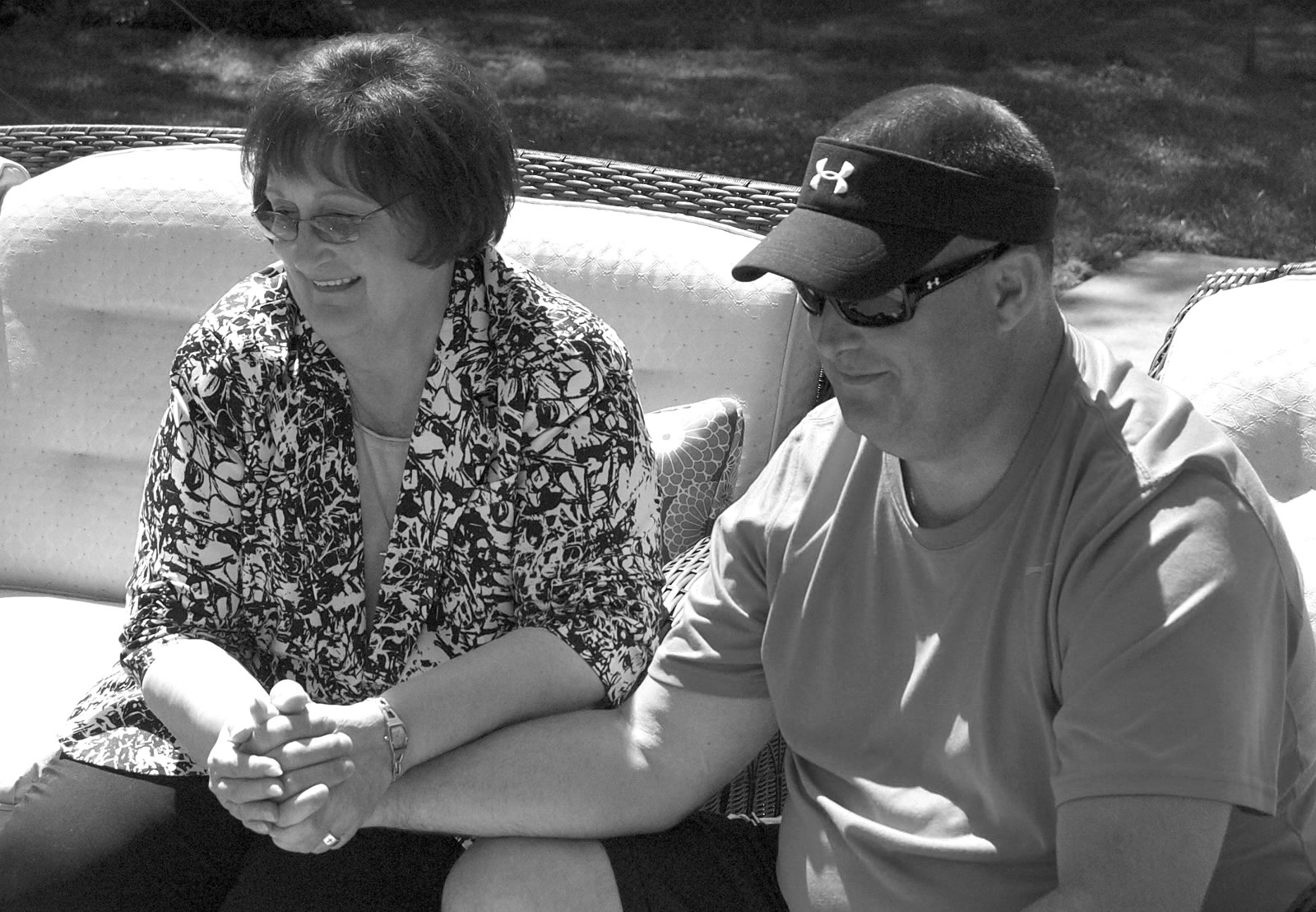 "Paula Alwin and David Hattaway, a parishioner of St. Joseph Church in Shawnee, met this spring after 45 years. Alwin gave birth to him in 1966 and placed the baby for adoption, believing she would never know him. Hattaway wanted to know more about her and searched for her this year. They began writing letters, made phone calls, and finally met in person. ""Before we met, I see that God really allowed us to get to know each other,"" Alwin said. They found they bear striking physical similarities and have many shared interests.  (Photo by Jessica Langdon)"