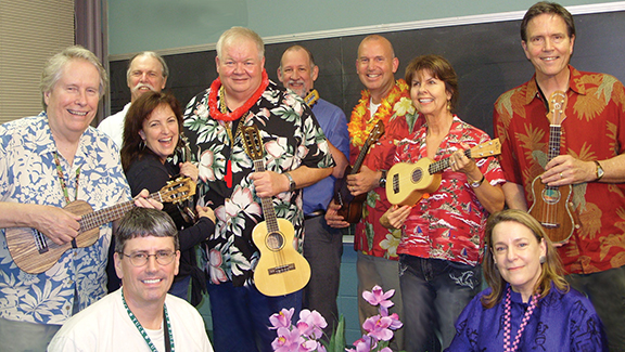PHOTO COURTESY OF FATHER KEN KELLY Father Ken Kelly and the Kansas City Ukesters will perform hits of World War I at 2 p.m. on Feb. 10 at the World War I Museum Auditorium at Liberty Memorial in Kansas City, Mo. The pictured Ukesters are: (back row, from left) Steve Mathews, Mike Walker, and Mike Kelly; (middle row) Chuck Wilson, Cynthia Van Roden, Father Ken Kelly, Shayron Liquie, and David Firman; (front row) Rick Sullivan and Nancy Howell.