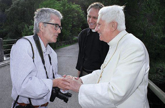 Spaziani gets a quick moment to chat with Pope Benedict XVI during a walk in the countryside.