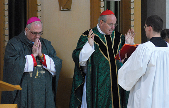 LEAVEN FILE PHOTO Archbishop Joseph F. Naumann has met a few of the names being tossed about as papabili, including Cardinal Christoph Schonborn of Austria (right).