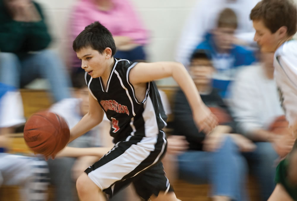 Leaven file photo A policy change within the Catholic Youth Organization and archdiocesan schools will prohibit games and activities from being held on Sundays in order to help keep holy the Lord's day.