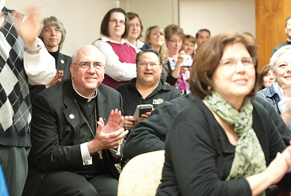 Archbishop Joseph F. Naumann reacts to the announcement that the church has a new pope at the chancery offices on March 13. The archbishop expects Pope Francis to rebuild and renew the church. Photo by Todd Habiger.