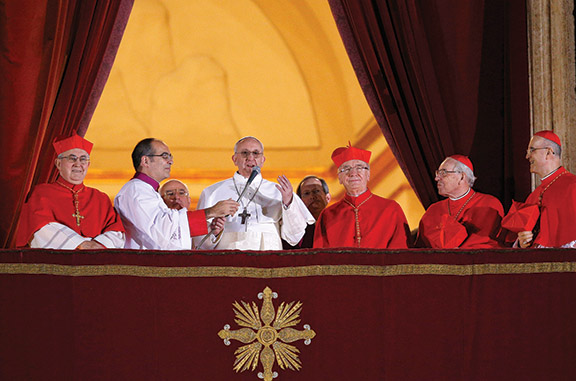 When Pope Francis greeted the crowd in St. Peter's Square the night of his election, he broke several traditions in the process. He refused to stand on a platform elevating him above the cardinals, kept his own cross instead of accepting a more ornate one, and asked the people to bless him before he blessed them. CNS photo by Paul Haring.