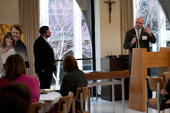 """Tony Brandt, right, shares an evangelization story at the Region IX stewardship conference on April 19 at Savior Pastoral Center in Kansas City, Kan. Brandt and Chris Stewart, left, both with the lay apostolate Casting Nets, detailed the """"Seven Pillars of Evangelization."""""""