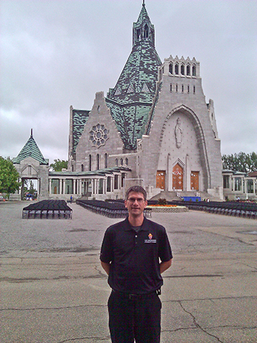 Deacon Larry Bowers stands in front of Our Lady of the Cape Shrine in Quebec, Canada. He will be ordained a priest for the archdiocese on May 25 at St. Matthew Church in Topeka.