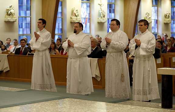 From left, Jaime Zarse, Adam Wilczak, Anthony Saiki and Mark Ostrowski were ordained to the transitional diaconate on May 18 at Most Pure Heart of Mary Church in Topeka. The four will be ordained to the priesthood next year. Photo by Susan McSpadden.