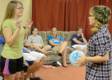 Leaven photo by Jill Ragar Esfeld Theresa Bagley (left) and Frankie Kelley (right) are the last two left in an energetic game of Categories at Christ the King Church in Topeka. Looking on are, from left, Ann Baldridge, Marya Feldt and Greg Bagley — all participants in a special summer youth program developed and led by two college-aged parishioners.