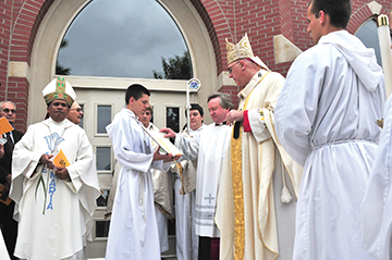 Archbishop Naumann blesses the new narthex at Sts. Peter and Paul Church in Seneca at a June 1 liturgy.