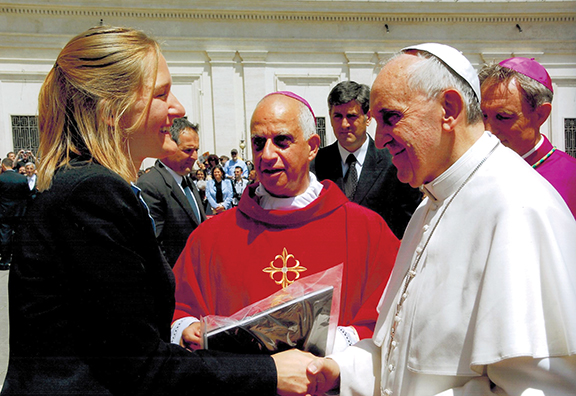Sister Janel Olberding met Pope Francis following Pentecost Mass May 19. In celebration of the Year of Faith, Pope Francis invited members of various movements, associations, and lay associations within the church to make a pilgrimage to Rome for the weekend of Pentecost. Photo courtesy of Sister Janel Olberding.