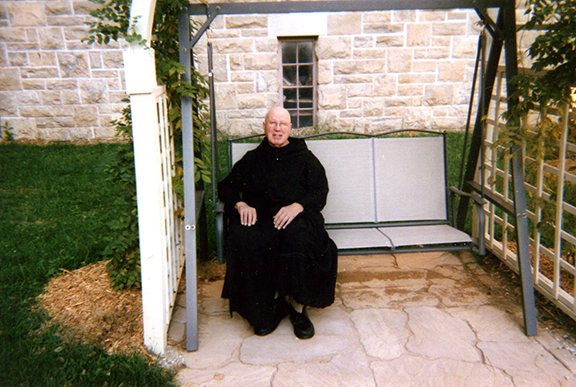 Father Jude Burbach, OSB, enjoys a peaceful moment on the grounds of St. Benedict's Abbey in Atchison. Father Jude died Aug. 22 at the abbey. He was remembered as a humble servant of God. Photo courtesy of St. Benedict's Abbey