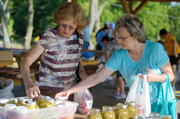 Mother Teresa of Calcutta parishioner Jean Walter, left, looks over Mother Teresa's canned goods during an outing with her sister Sylvia Nordhus.