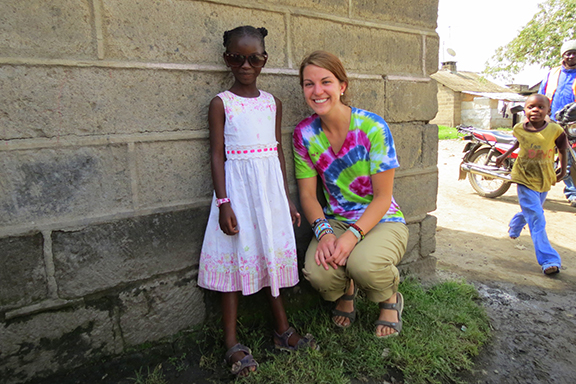 Katherine Meinig, right, meets Lynn, the seven-year-old girl she sponsors through the Christian Foundation for Children and Aging. Lynn lives in Kenya with her mother Rosemary and older sister Betty. Katherine's family in Paola has sponsored children through CFCA for years. Katherine and Lynn's family write back and forth, and Katherine, who is in the U.S. Air Force ROTC program at Iowa State University, worked with CFCA to meet Lynn and her family during a study abroad trip to Kenya this summer.