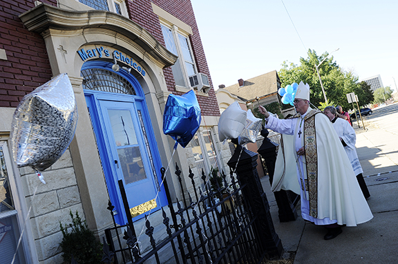 Archbishop Joseph F. Naumann blesses the newly opened Mary's Choices pregnancy center in Topeka. The 3-D sonograms offered inside the center are meant to help women and families facing unplanned pregnancies choose life. Leaven photo by Elaina Cochran.