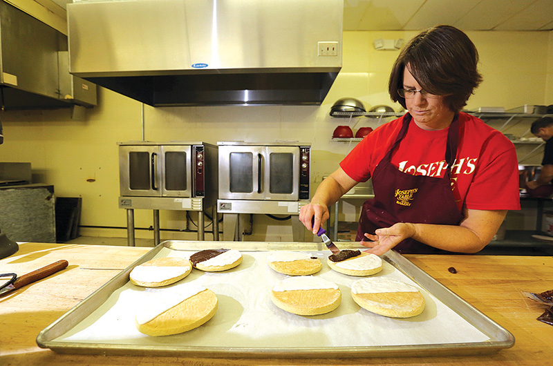 Stephanie Bicknell begins her day by preparing pastries for the oven.